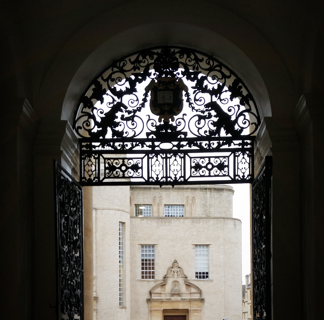 Archway overlooking the Bodleian Library Oxford with ornamental gate